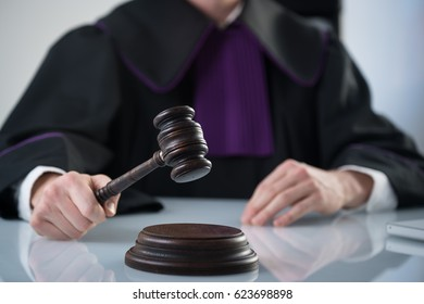 Juridical mallet on table in modern office. Judge and Justice