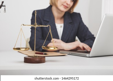 Jurisprudence concept. Woman advocate at the desk sitting isolated.