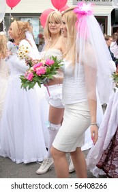 JURMALA - JUNE 13: 2nd annual wedding parade in resort city. Each year many brides from all country are participating in Bride parade - June 13, 2010 in Jurmala, Latvia.