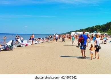 Jurmala, Latvia - August 18, 2013: People at the Baltic sea in Jurmala, Latvia recreational resort