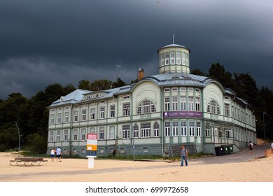 JURMALA, LATVIA - JULY 11, 2017: Summer day with dark overcast sky and low clouds in Jurmala, a seaside resort town on the Gulf of Riga with long stretch of white-sand beach.