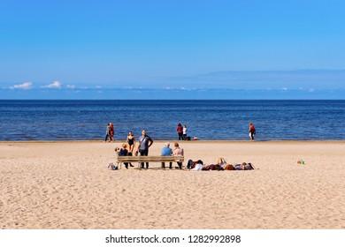 Jurmala, Latvia - September 2, 2018: People relaxing on Sandy beach on the Baltic Sea in Jurmala in Latvia.