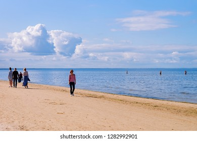 Jurmala, Latvia - September 2, 2018: People relaxing at Sandy beach on the Baltic Sea in Jurmala in Latvia.