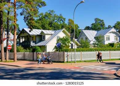 Jurmala, Latvia - September 2, 2018: Traditional house architecture and people in Jurmala in Latvia.
