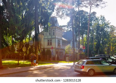 Jurmala, Latvia - September 2, 2018: Street with Traditional house architecture and people in Jurmala in Latvia.