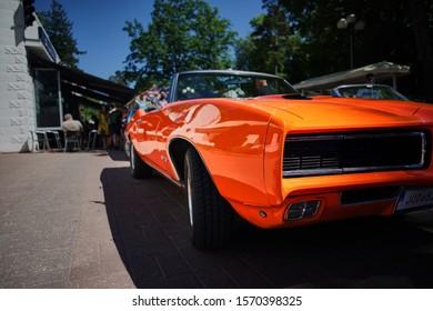 Jurmala, Latvija - 06.06.2018 Vintage classic car. Old and stylish orange Muscle car. Retro car