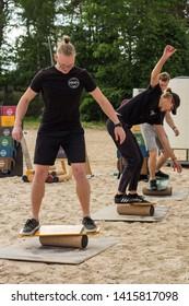 Jurmala resort city at Majori beach / Latvia - May, 2019: active young man on a stability board during sunny spring day
