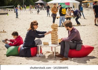 Jurmala resort city at Majori beach / Latvia - May, 2019: family playing giant jenga game by the beach during Jurmala resort festival
