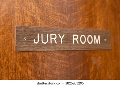 """""""Jury Room"""" sign on the wooden door of the court house."""