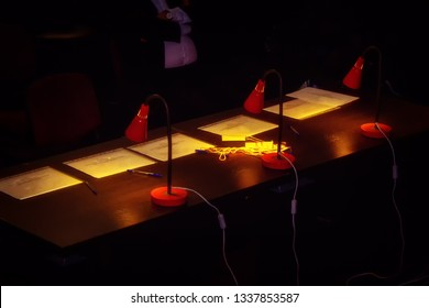 The jury table before the evaluation of participants in the dark. Places of judges of the selection Committee at the choice of the winner. Evaluation of players in a sports competition