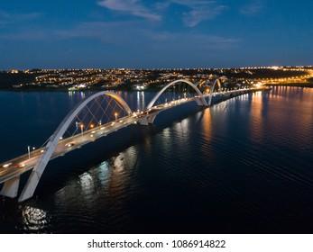 Juscelino Kubitschek Bridge over Paranoa Lake in Brasilia, Brazil. Aerial Night View.
