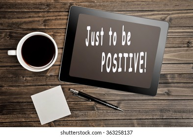 Just to be positive text written on digital tablet