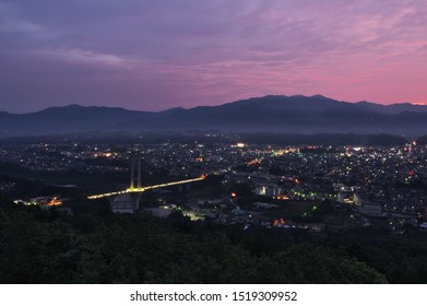 At just before sunrise, morning glow and night view of Chichibu city from The Chichibu Muse Park in Saitama Prefecture, Japan. Sep. 28, 2019.