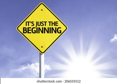 It's Just The Beginning road sign with sun background