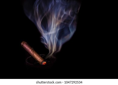 Just a cigar, a stogey, and some smoke in a darkened room.