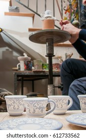 Just decorated coffee cups and saucers in the workshop of a pottery artisan in Caltagirone