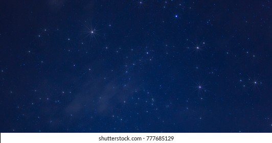 Just a few thin clouds in a photo of nighttime stars