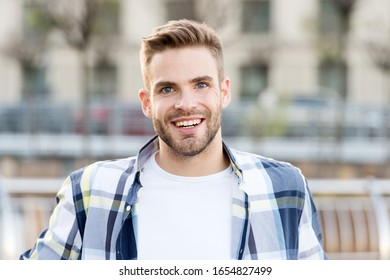 Just happy. Handsome male portrait. Facial hair and skin care concept. Handsome face. Handsome man unshaven face and stylish hair. Caucasian man urban background. Relaxed bearded man casual style.