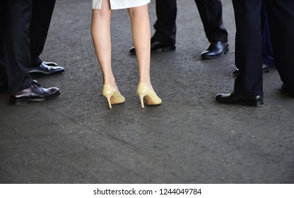 Just looking cool. Human legs in business fashion style. Female and male legs in shoes. Womens shoes on high heels. Classic mens shoes. Formal fashion trends to wear to office work.