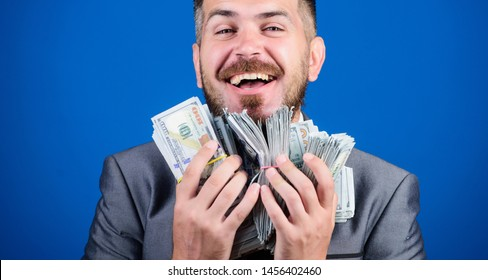 Just making money. businessman after great deal. Finance and commerce. happy bearded man has a lot of money. Business and sport success. Billioner with dollar banknotes. winning a lottery.
