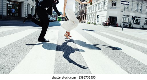 Just married bridal couple walking around Copenhagen, happy bride and groom together.