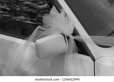 Just married car with a white bow on the driving mirror (Marche, Italy, Europe)