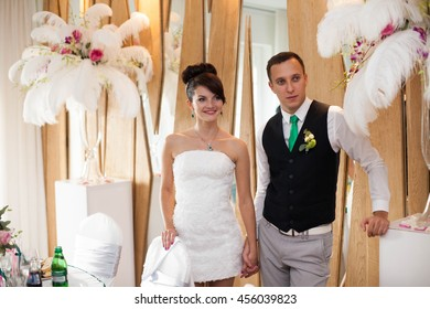 just married couple is celebrating wedding in stylishly decorated restaurant