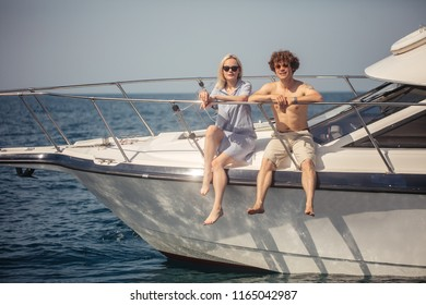 Just married couple decide to have a sea trip on summer holydays. Man rent a sailing boat and getting a good ride along Black sea Coast together with a girlfriend