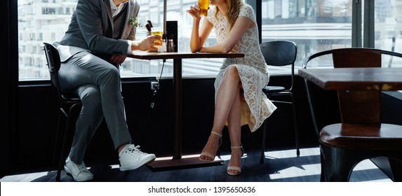 Just married couple having a beer in the cafe.