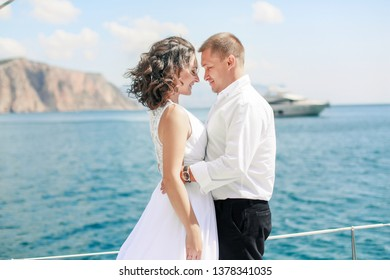 A Just married couple on yacht. Happy bride and groom on their wedding day.