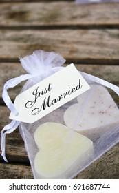 just married heart soap in gift bag wooden background gift bag wedding favor