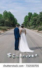 just married on the road with metal canisters