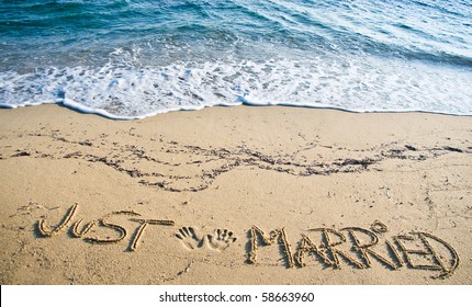 Just Married written in the Sand on the Beach