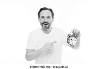Just on time. Man bearded mature guy hold clock isolated on white. Man with beard check what time is it. Time management skills. Personal schedule and daily regime. Alarm clock morning time.