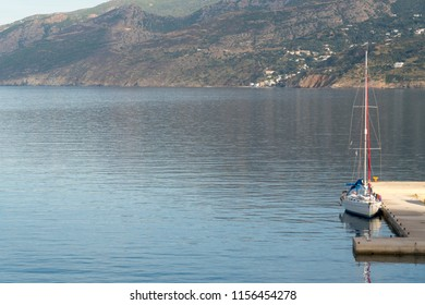 just one sailboat is docked in port of ikaria