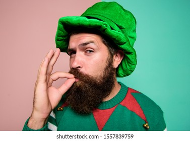 Just perfect. Christmas elf. Elf concept. Happy celebration. Bearded elf. Winter carnival. St Patricks day. Hipster with beard wearing green party costume excellent. Cheerful man celebrate holiday.