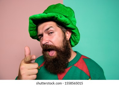 Just perfect. St Patricks day. Hipster with beard wearing green party costume pointing. Cheerful man celebrate holiday. Christmas elf. Elf concept. Happy celebration. Bearded elf. Winter carnival.