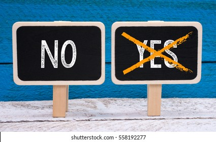 Just say NO - Evaluation concept chalkboards on wooden background