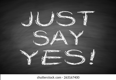 Just say yes text is written by white chalk on blackboard.