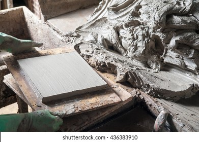 Just squared tiles made of clay and lavic sand ready to be fired - Shutterstock ID 436383910