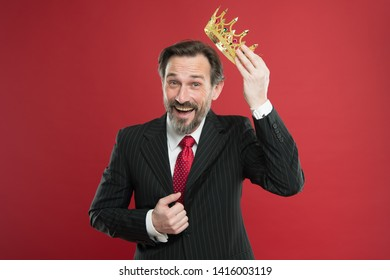 I am just superior. Become king ceremony. Award and achievement. Feeling superiority. Being superior human. Man bearded guy in suit hold golden crown symbol of monarchy. Superior and narcissistic.