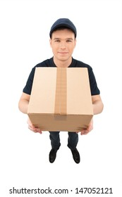 Just in time. Top view of cheerful young deliveryman stretching out the cardboard box and smiling while isolated on white
