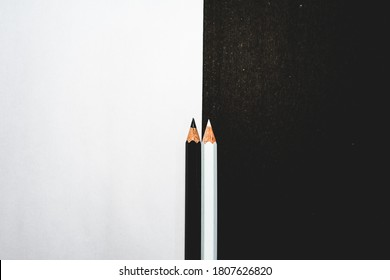 Just two pencils explaining the contrast