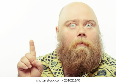Just unbelievable. Portrait of funny bearded man pointing up with a surprised face expression while standing isolated over white background