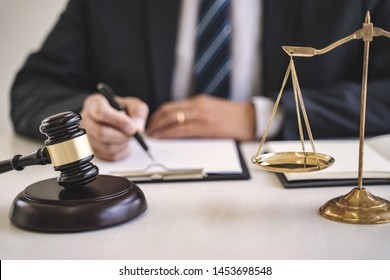 Justice and Agreement concept, Business advisor or Lawyers consultant working with contract in law firm.