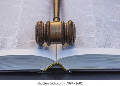 justice allegory/judge gavel on a opened big book close up