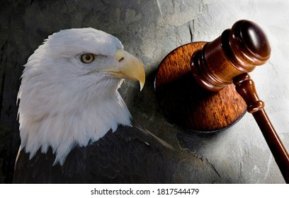 Justice, eagle and a wooden law gavel .