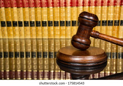 Justice gavel with blurred law books in the background