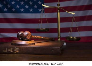 Justice gavel on Law book with scales of Justice in the background