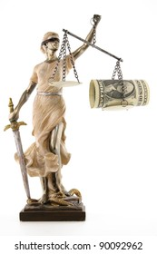 Justice (greek:themis,latin:justitia) blindfolded with scales, sword and money on one scale. Corruption and bribing concept